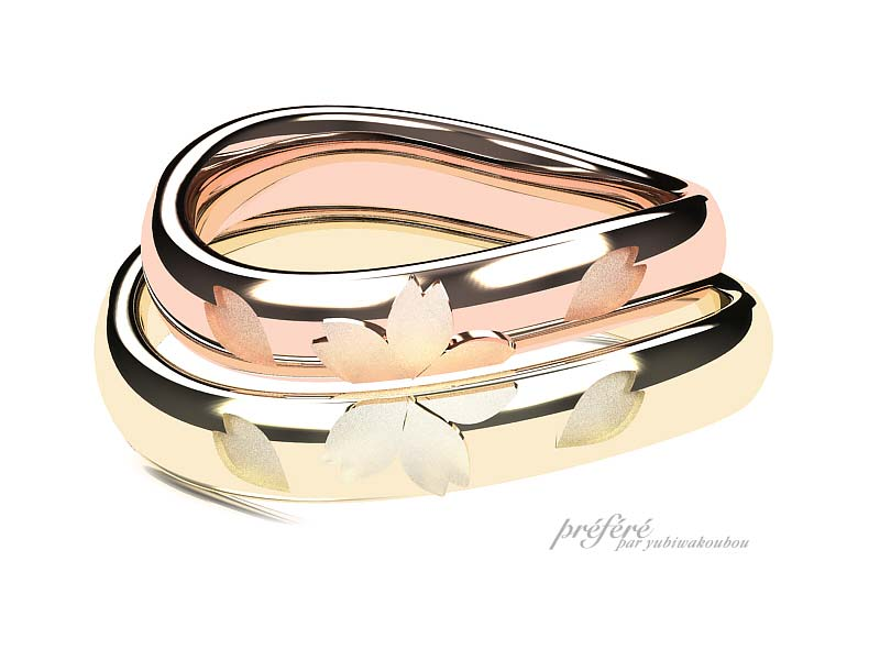 桜の花モチーフとリング内側に肉球と誕生石の結婚指輪