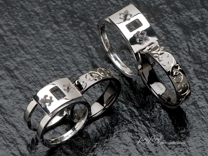 手彫りのデザインをいれたブラックリングをセットするオーダーメイドの結婚指輪