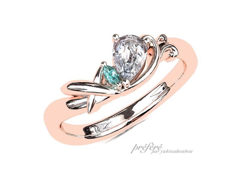 ペアシェイプダイヤに飛行機を添えた婚約指輪