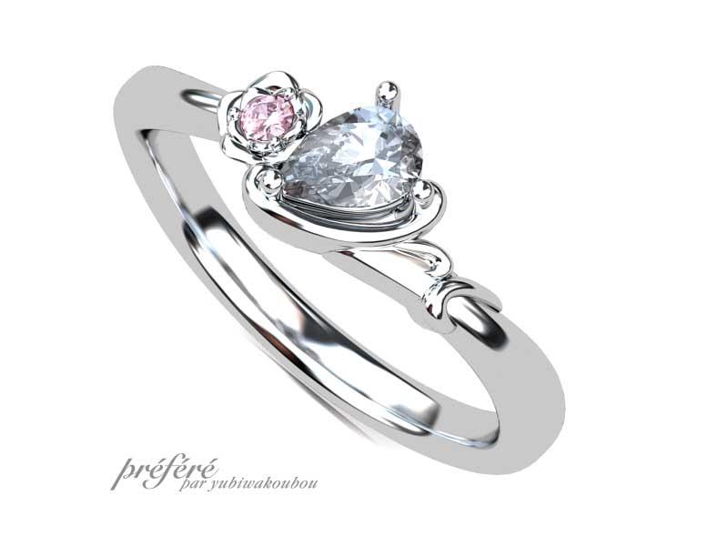 薔薇の花とイニシャルHの婚約指輪